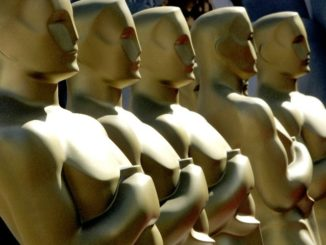 Large display statue of the Oscar statuette wait to be painted on the red carpet outside the Kodak Theatre in Hollywood 04 March 2006 as the area is prepared for the 78th Academy Awards that will be held 05 March.     AFP PHOTO/Timothy A. CLARY